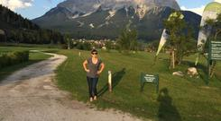 Gemma in Lermoos, Austria, in the shadow of the mighty Zugspitze, one of the spectacular peaks in the Zugspitz Arena, which is a vast grassy plateau carved out of the glacial valley