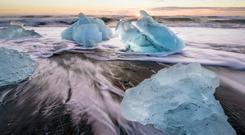The Icelandic landscape abounds with dramatic sights, including geysers, lava fields and volcanic black-sand beaches, such as this one near Jokulsarlon glacier lagoon