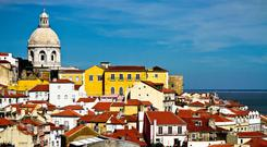 Lisbon, one of Europe's oldest cities, is strategically positioned at the mouth of the Tagus. Many explorers set sail from the city's docks, returning with untold wealth and tales of new lands. Photo: Artur Cabral