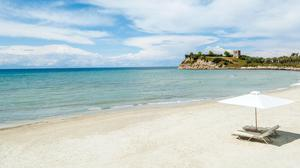 The sparkling Aegean Sea laps the beach at the Sani Resort in Greece