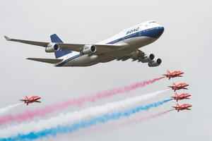 A British Airways special liveried Boeing 747 takes to the skies alongside the Red Arrows during the 2019 Royal International Air Tattoo at RAF Fairford, England. The Boeing 747 was painted in British Overseas Airways Corporation (BOAC) livery to mark British Airways' centenary. Photo by Ian Gavan/Getty Images for British Airways