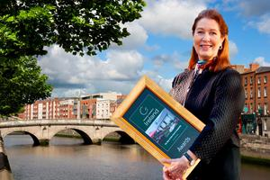 Composite: Georgina Campbell with one of her awards (Dublin in background).