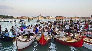 Boat picnics at sunset during the Redentore festival