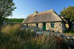 The vernacular architecture of the west is just part of its charms; pictured is An Sceach Gheal, one of the 17th century cottages at Cnoc Suain in Spiddal