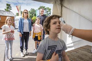 Park life: Journalist Orla Neligan and husband Alan with their children, twins Ruby and Martha (8) and Flynn (7) having a temperature check at Tayto Park. Photo: Mark Condren