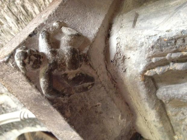 The mysterious Sheela-na-gig on the bishop's tomb in Kildare.