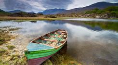 Lough Leane — the biggest of Killarney National Park's three lakes — is home to the isle of Inisfallen where St Finian founded his monastery