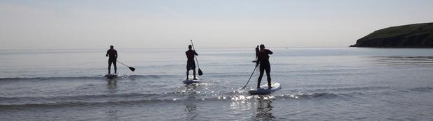 Paddle boarding in the ocean at Ardmore isn't cardio, there's no adrenaline pumping, it is pure mindfulness