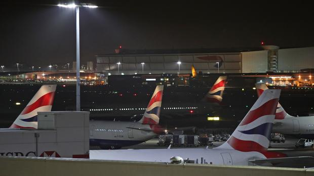 Planes at Terminal 5 at Heathrow after departures were temporarily suspended following reports of drones at the airport (PA)