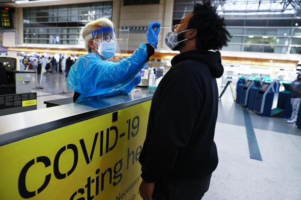 A man receives a nasal swab Covid-19 test at Los Angeles International Airport (LAX). Photo: Mario Tama/Getty Images