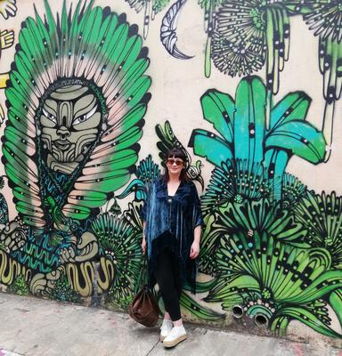 Aine takes in the sights of Beco de Batman, a warren full of lanes brought to life by artists