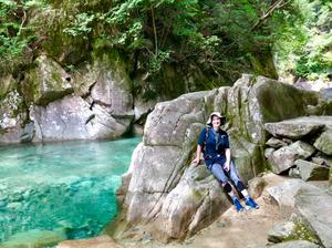 Gemma pausing to rest on the trail amid the stunning scenery of the Kiso Valley
