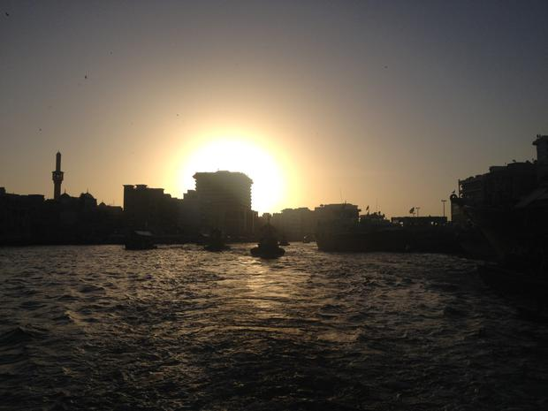 WATER TAXI: Abras - wooden boats - crossing Dubai Creek, which is in the old town, at sunset.