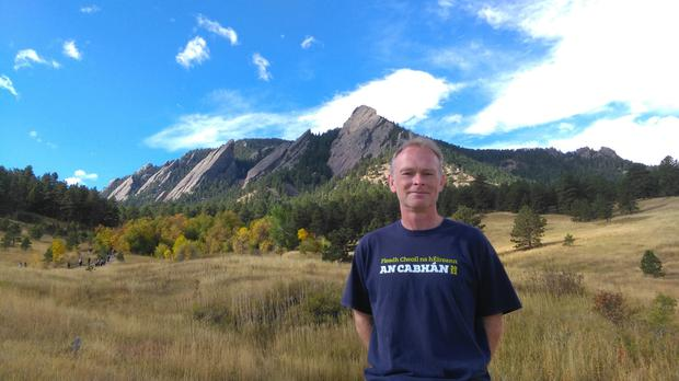 Shane out hiking the Flatirons in the foothills of Boulder - the highly-educated and liberal town that Donald Trump would like to ban