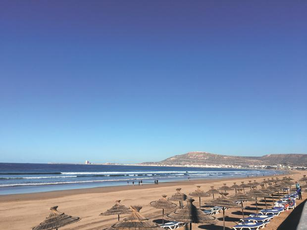 The beautiful beach at Agadir - the 'Miami of Morocco' - with the walls of the 16th century kasbah visible on the hill in the background