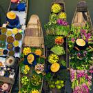 The floating market boats are still piled high with tropical fruit and vegetables, fresh, ready-to-drink coconut juice and local food cooked from floating kitchens - located right on the boat