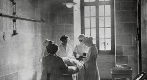 British nurses assist in an operation in France during World War I. Getty Images