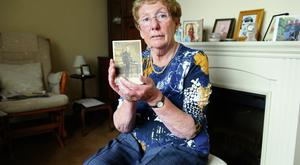 Eilis Lambe with a photo of her grandfather Lance Sergeant William Reilly.