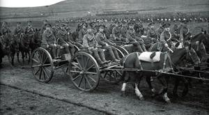 Artillery of the Irish Division marching past King George V during an inspection.
