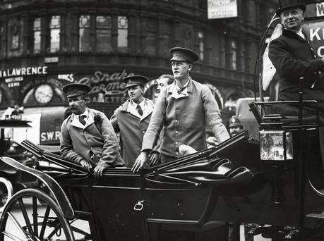 Sergeant Michael John O'Leary, from Macroom, Co Cork, with fellow wounded Irishmen on a podium in London after he returned home in July 1915