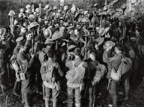Members of the First Battalion of the Irish Guards hear of the Armistice