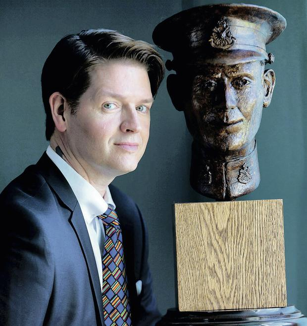 Sculptor Christian Corbet with the portrait bust of Irish-born Canadian soldier Pte Thomas Lawless, who died in France in 1915. Photo: Paul Sherwood.
