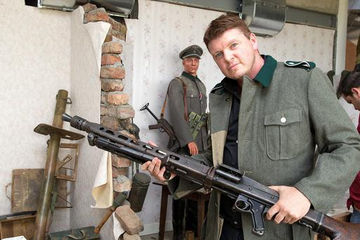 Irish Independent journalist Graham Clifford with a German MG 42 machine gun which is part of a collection of military weapons which are on view at the Irish War Museum at Starinagh, Collon, Co Meath.