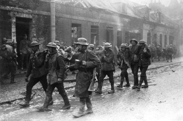 Prisoners of war: A German soldier guides several British troops, including a few of the injured, in Saint-Quentin, France during the Spring Offensive of March 1918. Photo: Getty