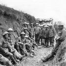 Forgotten men of the trenches: soldiers from the Royal Irish Rifles rest during the opening hours of the Battle of the Somme in 1916