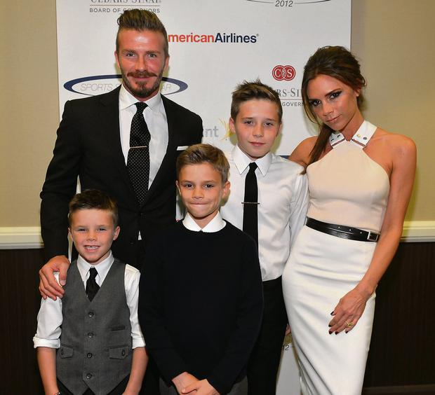 David Beckham, wife Victoria Beckham and sons (L-R) Cruz, Romeo and Brooklyn.