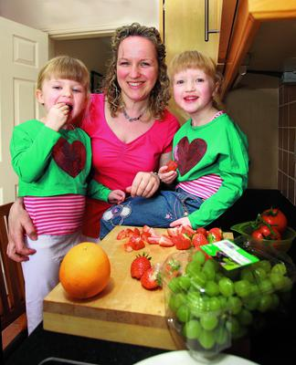 Laura Davies gets some help from sisters Lisa,3, and Abbie,4, as she tries out the 5:2 diet ......at home in Delgany  Pix Ronan Lang/Feature File