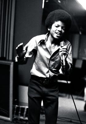 Michael Jackson...FILE - In this 1972 file photo, singer Michael Jackson at age 13, the youngest member of the singing group Jackson Five, sings in his home in Encino, Ca. (AP Photo, file)...I
