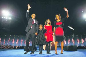 US President Barack Obama with wife Michelle and daughters Sasha and Malia in Grant Park, Chicago.