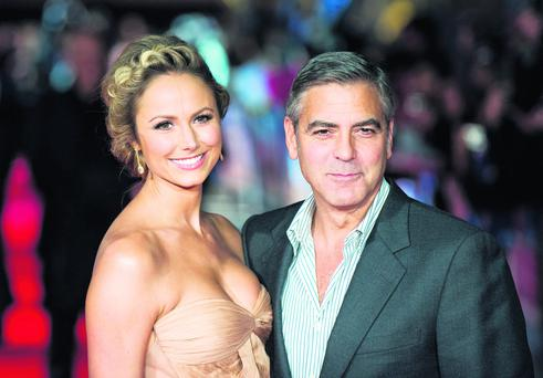 LONDON, ENGLAND - OCTOBER 20: Actor George Clooney and Stacy Keibler attend