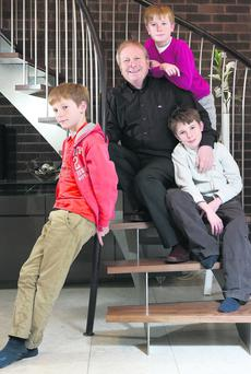 Ian Mucklejohn with his 11 year old sons (L-R) Lars, Piers and Ian (top) at their home in Newbury, Berkshire.