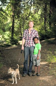 Johnny O'Callaghan with Odin, the boy he adopted from an orphanage in Uganda.