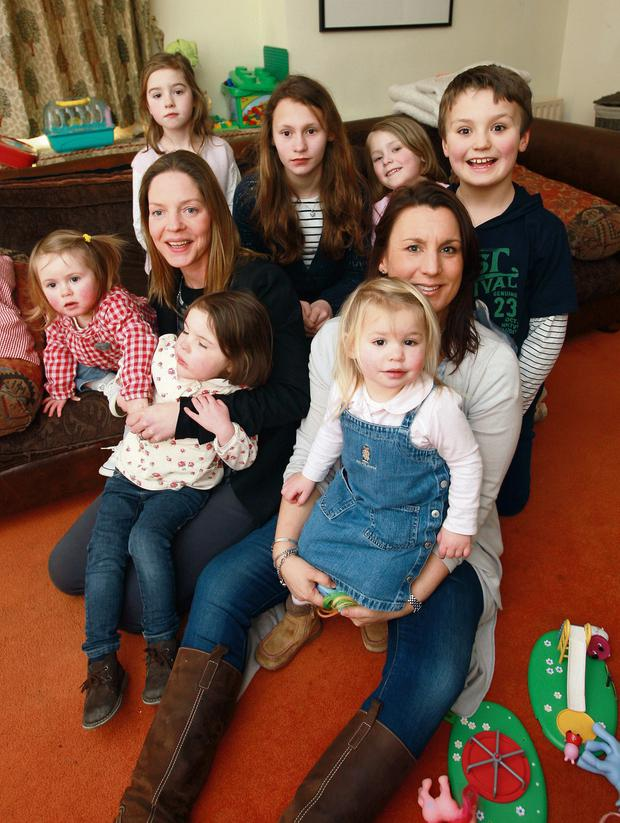 Twice Smitten.... Mums Cathy Slattery and Samantha Brigg with their collection of 7 children who were the inspiration for their pre loved kids clothes business, Ellis,Lulu,Isabelle,Honor,Clara,Georgia and Tom. Photo: Ronan Lang