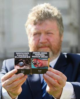 Minister for Health, James Reilly, T.D. Ireland is set to become the second country in the world to introduce plain pack cigarettes. Picture credit; Damien Eagers / Irish Independent
