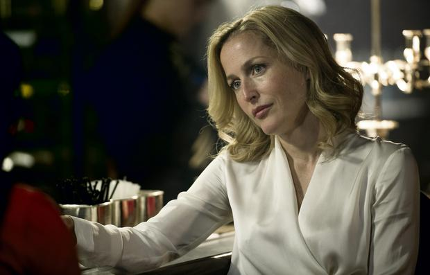 The real star of Gillian Anderson's crime drama is her silk blouse.