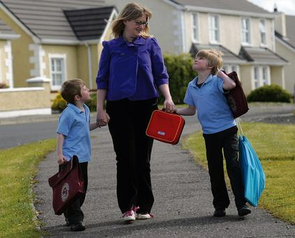 Pull the other one: Heidi Scrimgeour, pictured with sons Edan and Zac, was told chewing gum takes 25 years to digest