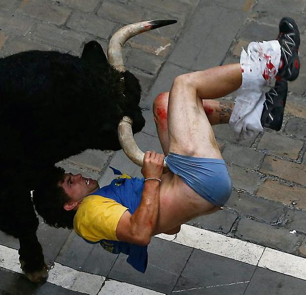 A man is gored during the bull run