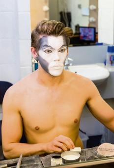 Cast member Ben Palmer getting ready for a performance