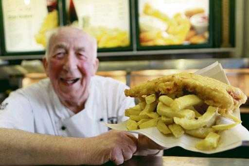 Something fishy: George Watson serves up a fresh cod and chips.