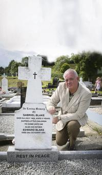 Pascal Blake at his brother and father's graves.