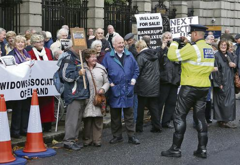 A garda takes a photo of some protesters outside the Dáil last Tuesday