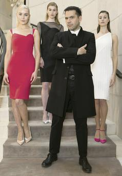 French fashion designer Roland Mouret launching his new collection at Brown Thomas, Dublin, with models Teo in raspberry; Eve in black; and Joanne in white.