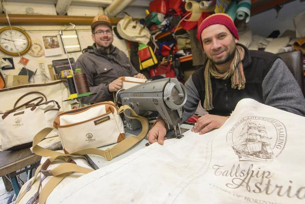 Brothers Attila (l) and Levente Magyar of Mamukko, upcycling the sails of sunken tall ship Astrid into designer bags