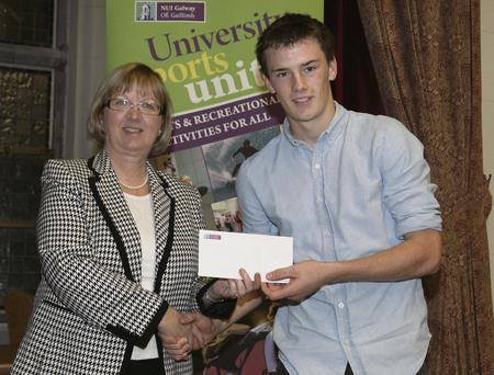 Pictured receiving a sports scholarship from NUI Galway's Dr Pat Morgan, was Clare hurler Robert Duggan from Clarecastle, Co Clare