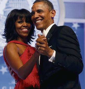 First Lady of fancy footwork: Michelle Obama, dancing with hubby Barack, wants her guests to get down and boogie