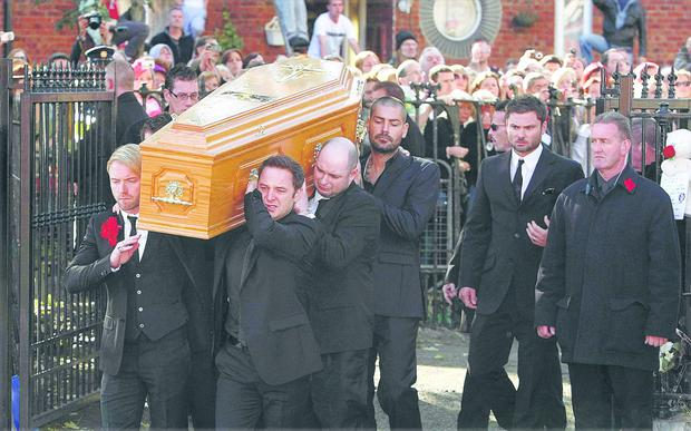 Boyzone members help carry Stephen Gately's coffin at his funeral in 2009.